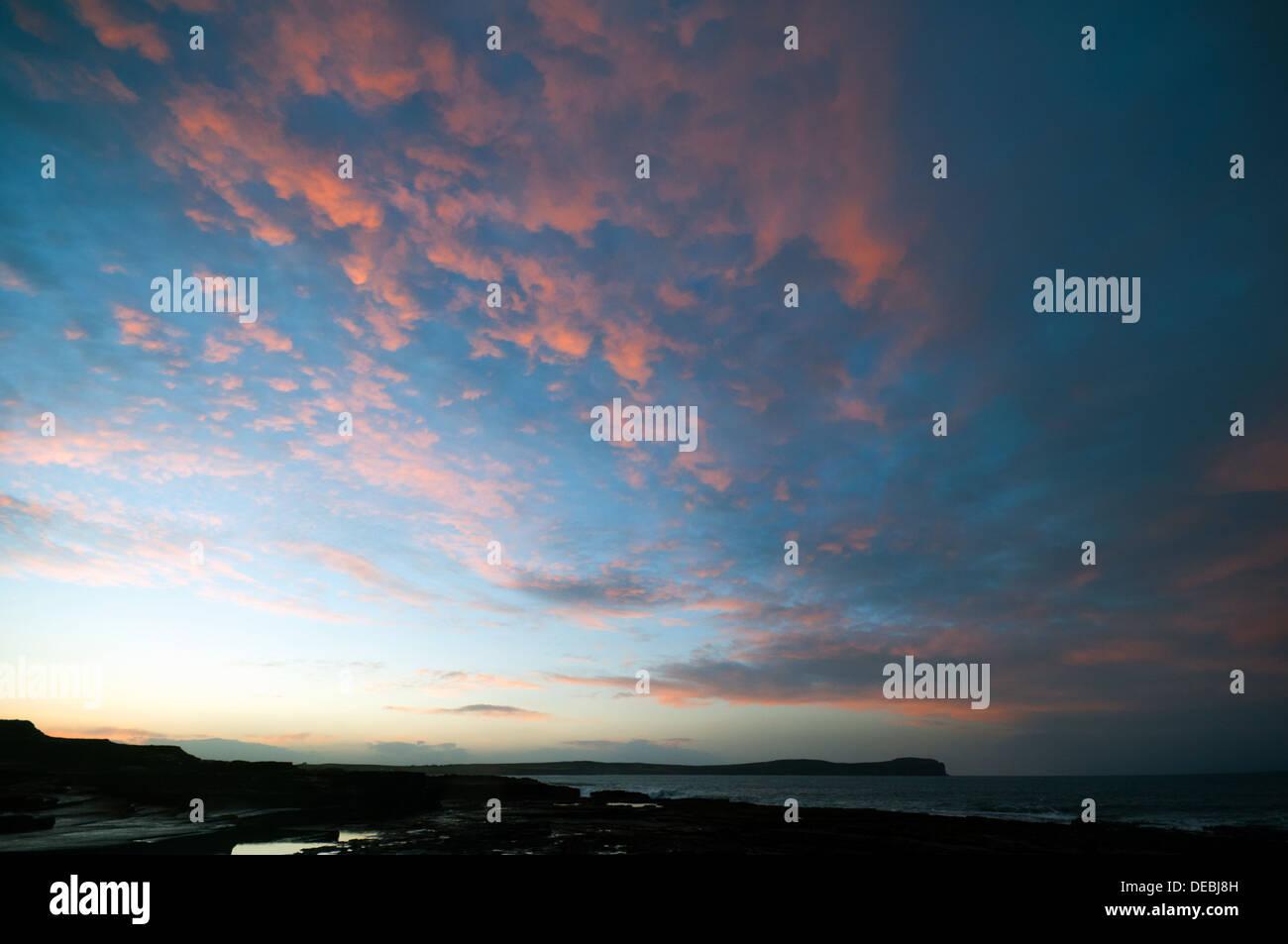 Sunset over Dunnet Head from near Skarfskerry, Caithness, Scotland, UK - Stock Image