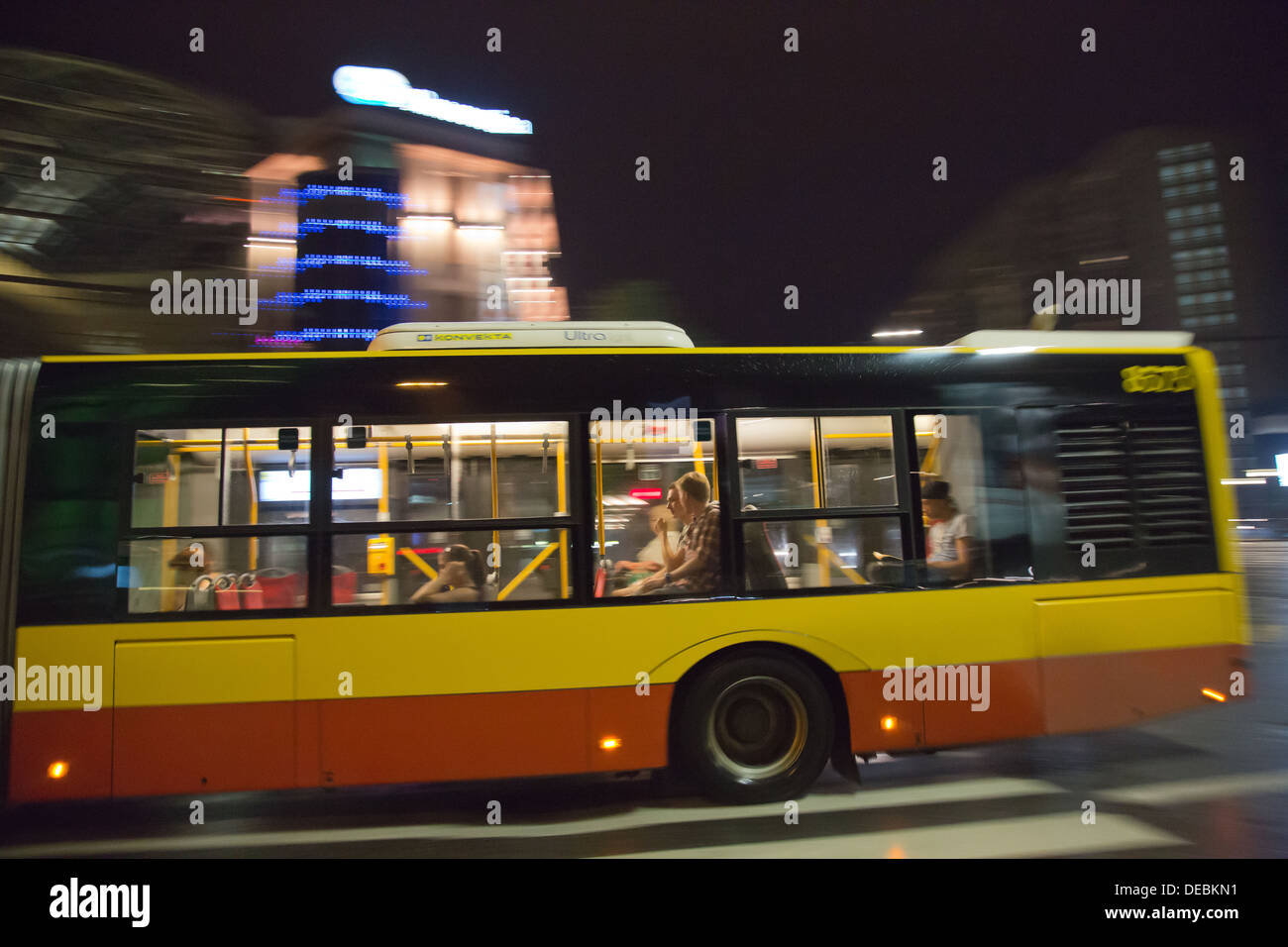 Warsaw, Poland, a bus drives past - Stock Image