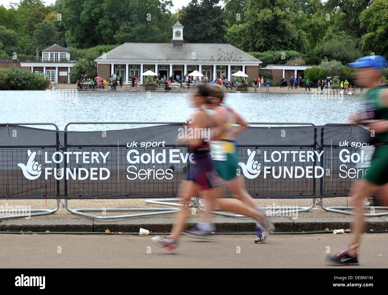 London, UK. 15th Sep, 2013. Competitors go past the Serpentine cafe. PruHealth World Triathlon Grand Final. Hyde Park. London. 15/09/2013. © Sport In Pictures/Alamy Live News - Stock Image