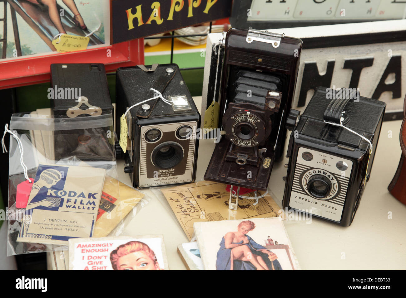 Vintage cameras for sale at an antiques fair - Stock Image