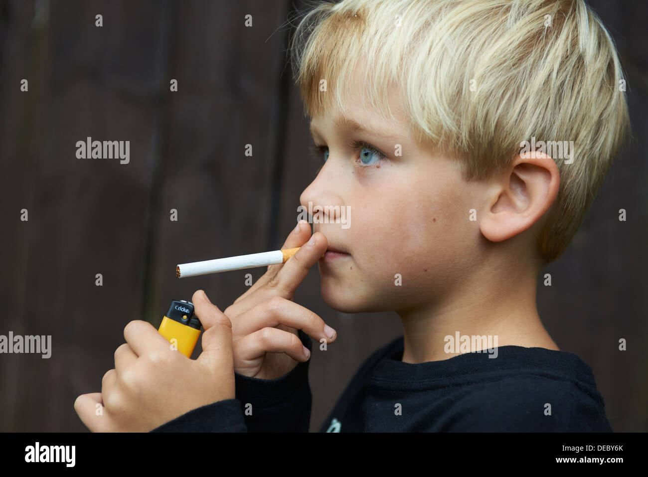 child blond boy smoking cigarette   young smoker stock