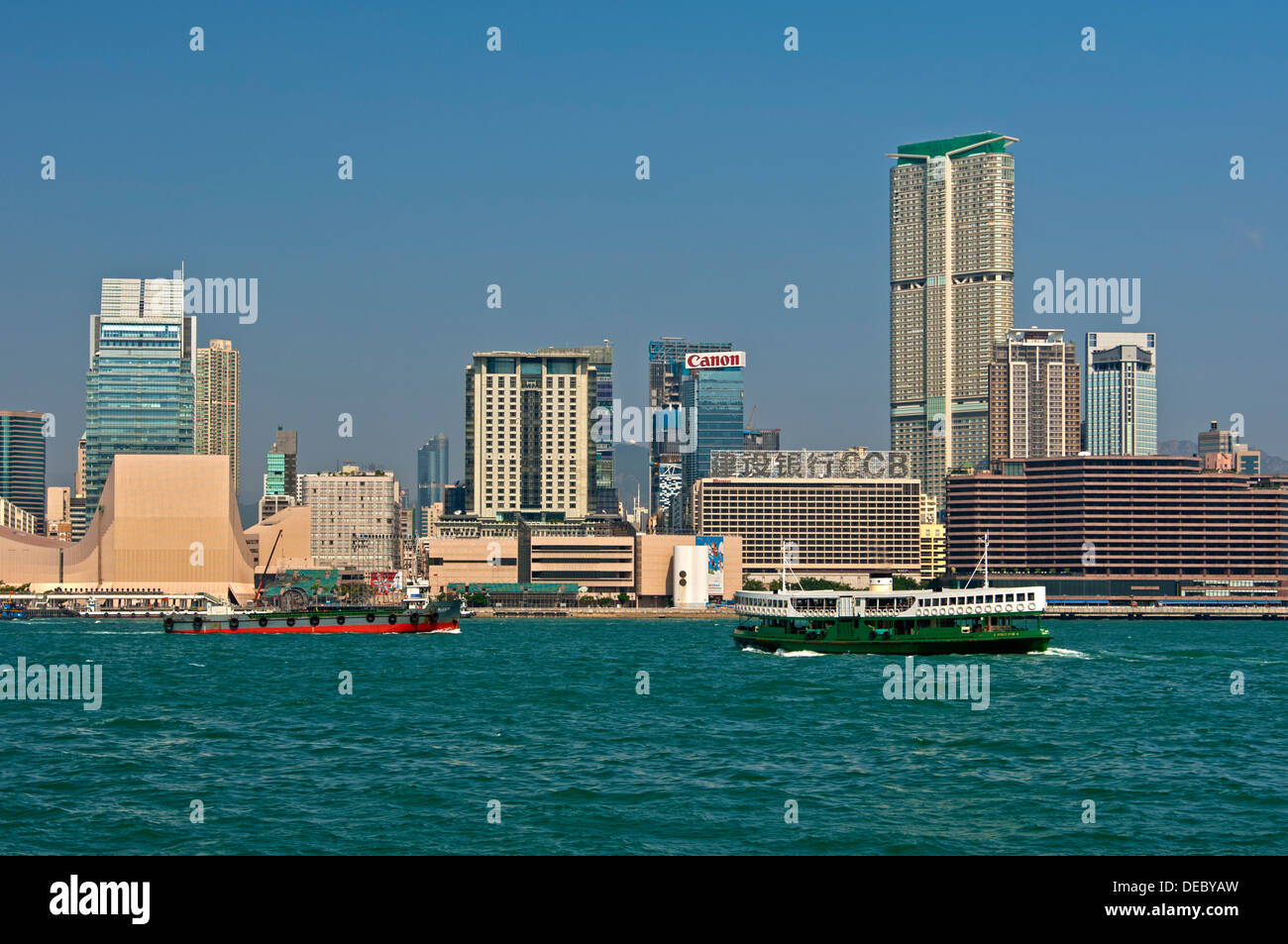 Victoria Harbour and skyscrapers in the district of Tsim Sha Tsui, from Hong Kong Island, Kowloon, Hong Kong, Hong Stock Photo