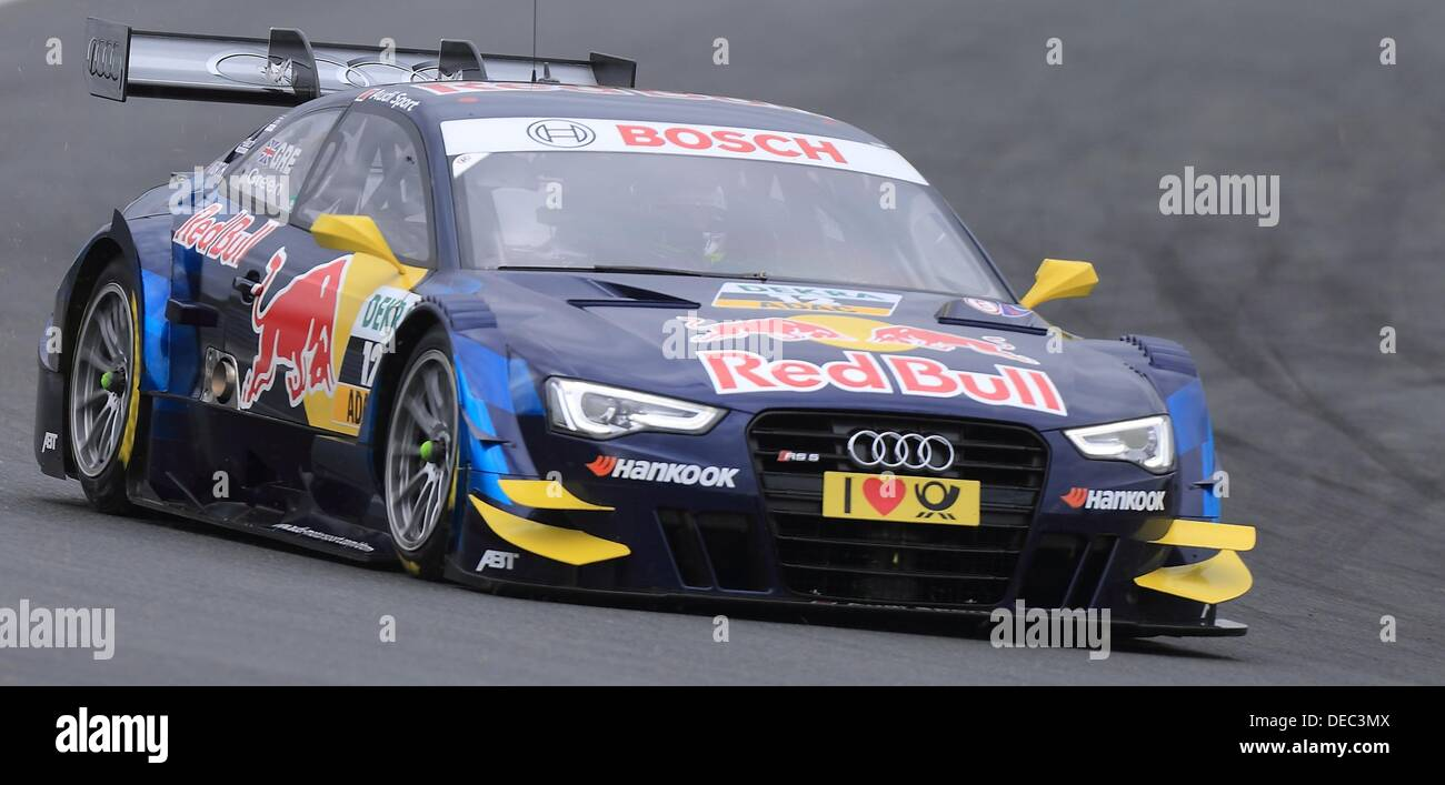 Oschersleben, Germany. 15th Sep, 2013. The British Audi-Pilot Jamie Green drives his race car on the racetrack of Stock Photo