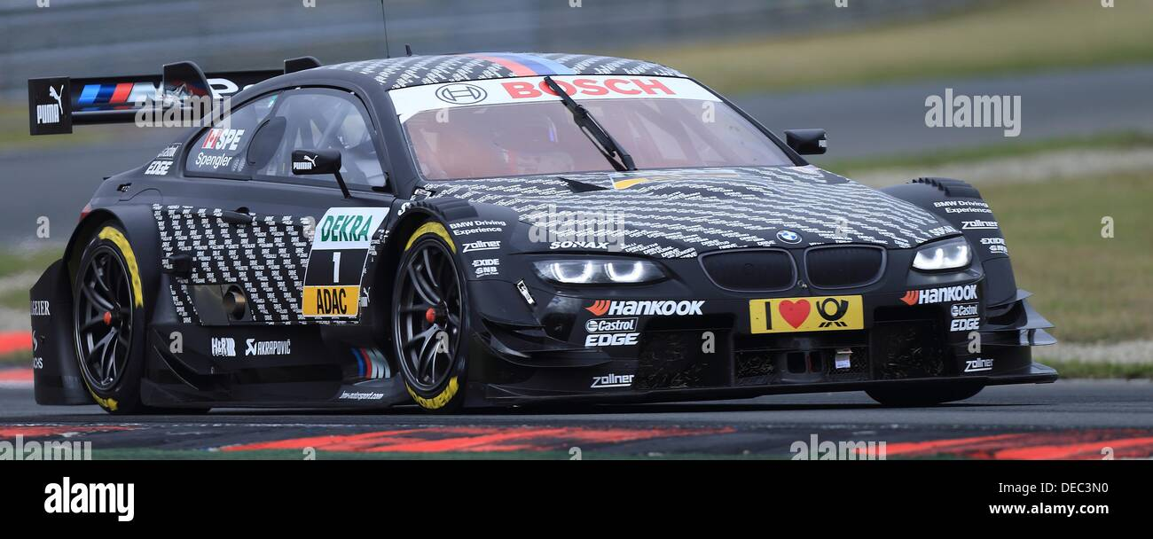 Oschersleben, Germany. 15th Sep, 2013. The Canadian BMW-Pilot Bruno Spengler drives his race car on the racetrack Stock Photo