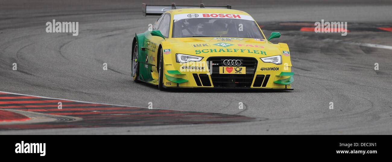 Oschersleben, Germany. 15th Sep, 2013. The German Audi-Pilot Mike Rockenfeller drives his race car on the racetrack Stock Photo