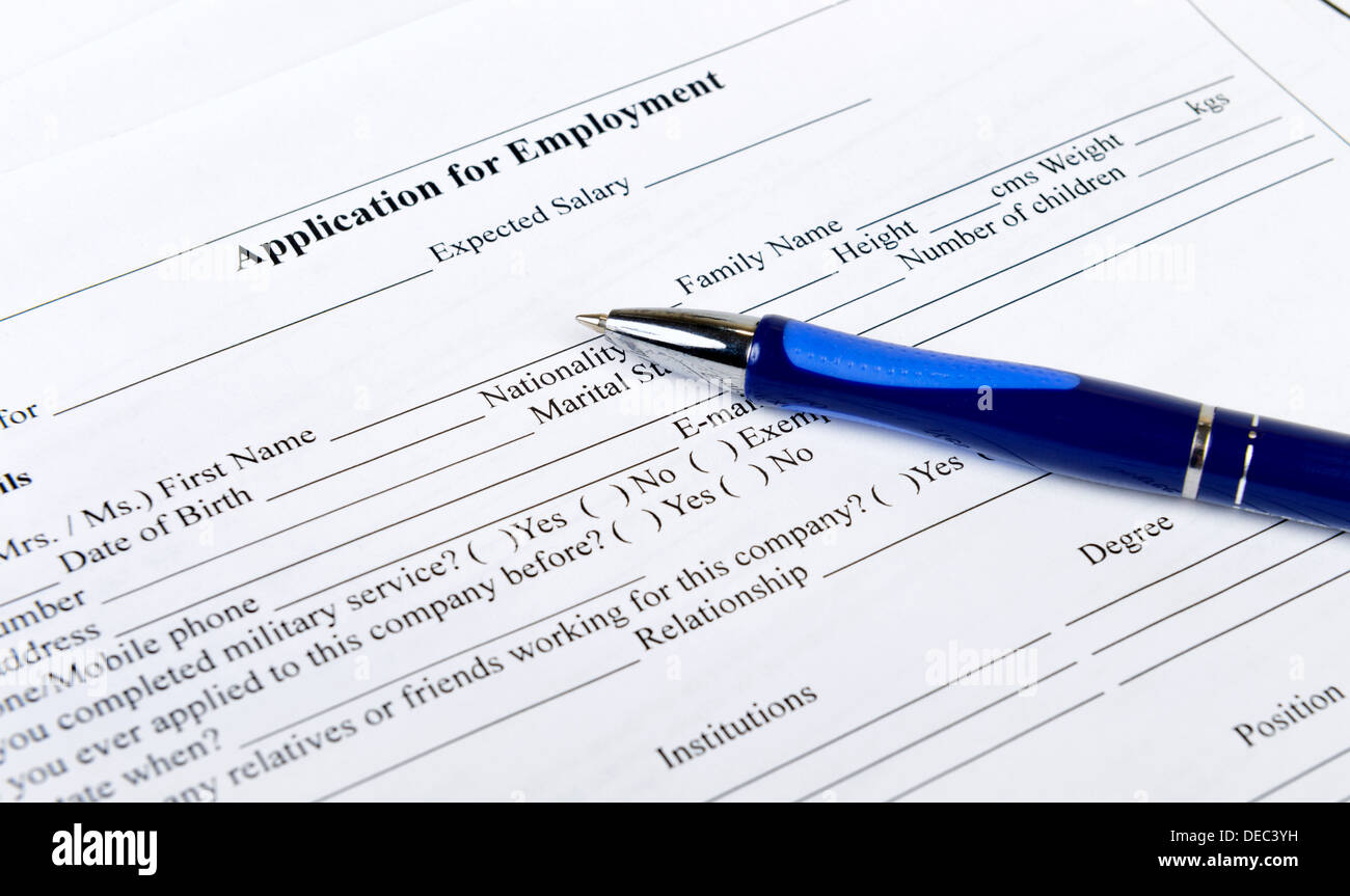 application form for employment with pen - Stock Image
