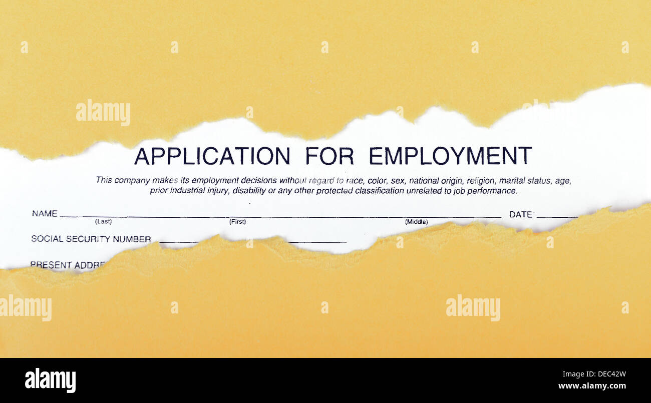 application form for employment over scrap ragged carton - Stock Image
