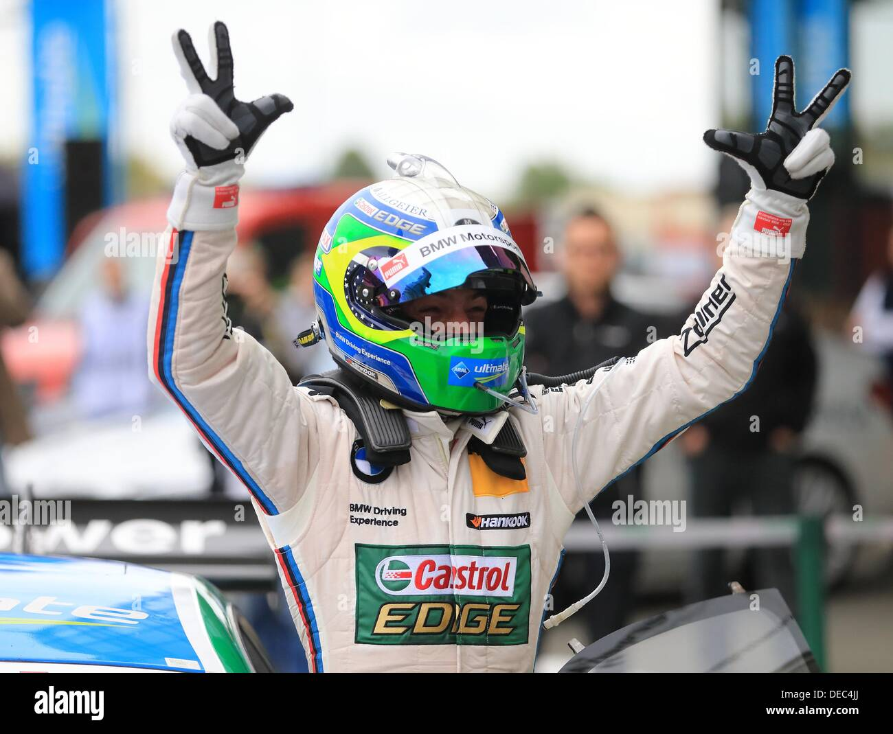 Oschersleben, Germany. 15th Sep, 2013. The Brazilian BMW-Pilot Augusto Farfus cheers after winning the 8th race Stock Photo