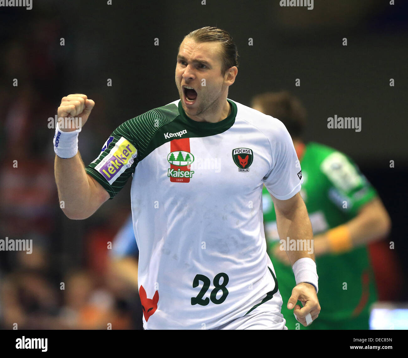 Berlin's Pavel Horak celebrates during the Bundesliga handball match between SC Magdeburg and Fuechse Berlin at Getec-Arena in Magdeburg, Germany, 15 September 2013. Photo:JENS WOLF - Stock Image