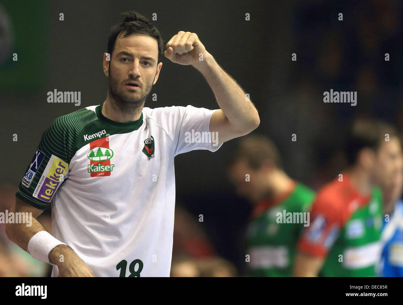 Berlin's Iker Romero celebrates during the Bundesliga handball match between SC Magdeburg and Fuechse Berlin at Getec-Arena in Magdeburg, Germany, 15 September 2013. Photo:JENS WOLF - Stock Image