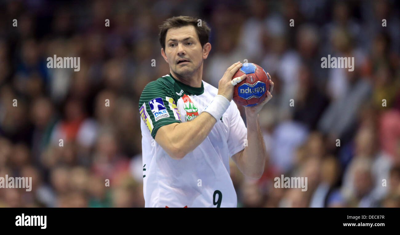 Berlin's Denis Spoljaric in action during the Bundesliga handball match between SC Magdeburg and Fuechse Berlin at Getec-Arena in Magdeburg, Germany, 15 September 2013. Photo:JENS WOLF - Stock Image