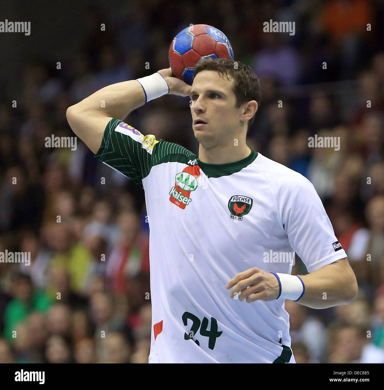 Berlin's Bartlomiej Jaszka in action during the Bundesliga handball match between SC Magdeburg and Fuechse Berlin at Getec-Arena in Magdeburg, Germany, 15 September 2013. Photo:JENS WOLF - Stock Image