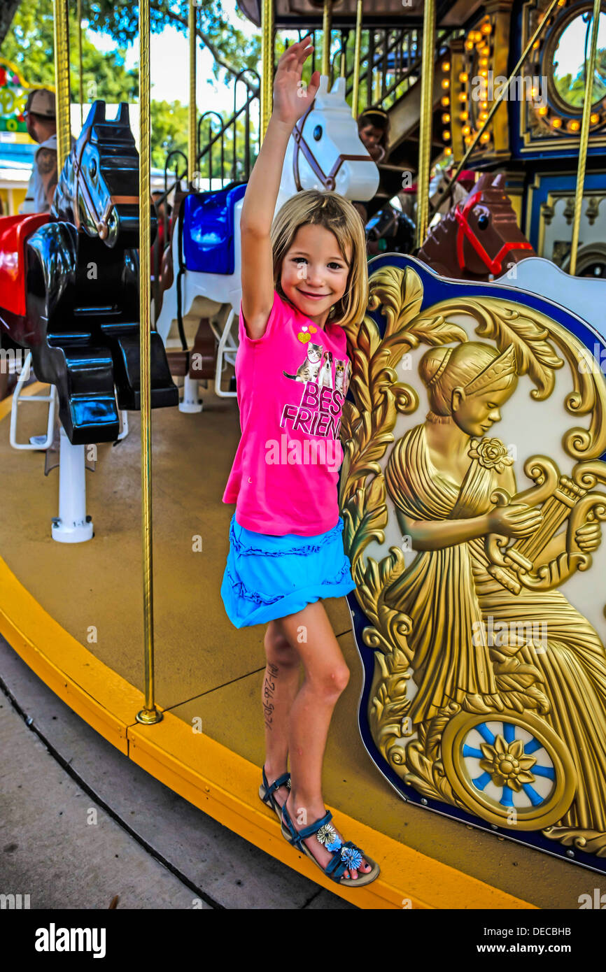 Young girl enjoys a ride on a carousel at the Legoland Theme Park Florida Stock Photo