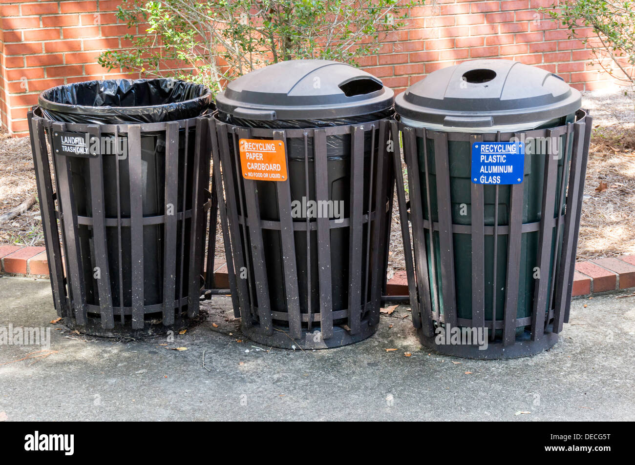 Large, durable exterior recycling and landfill trash cans receptacles. - Stock Image