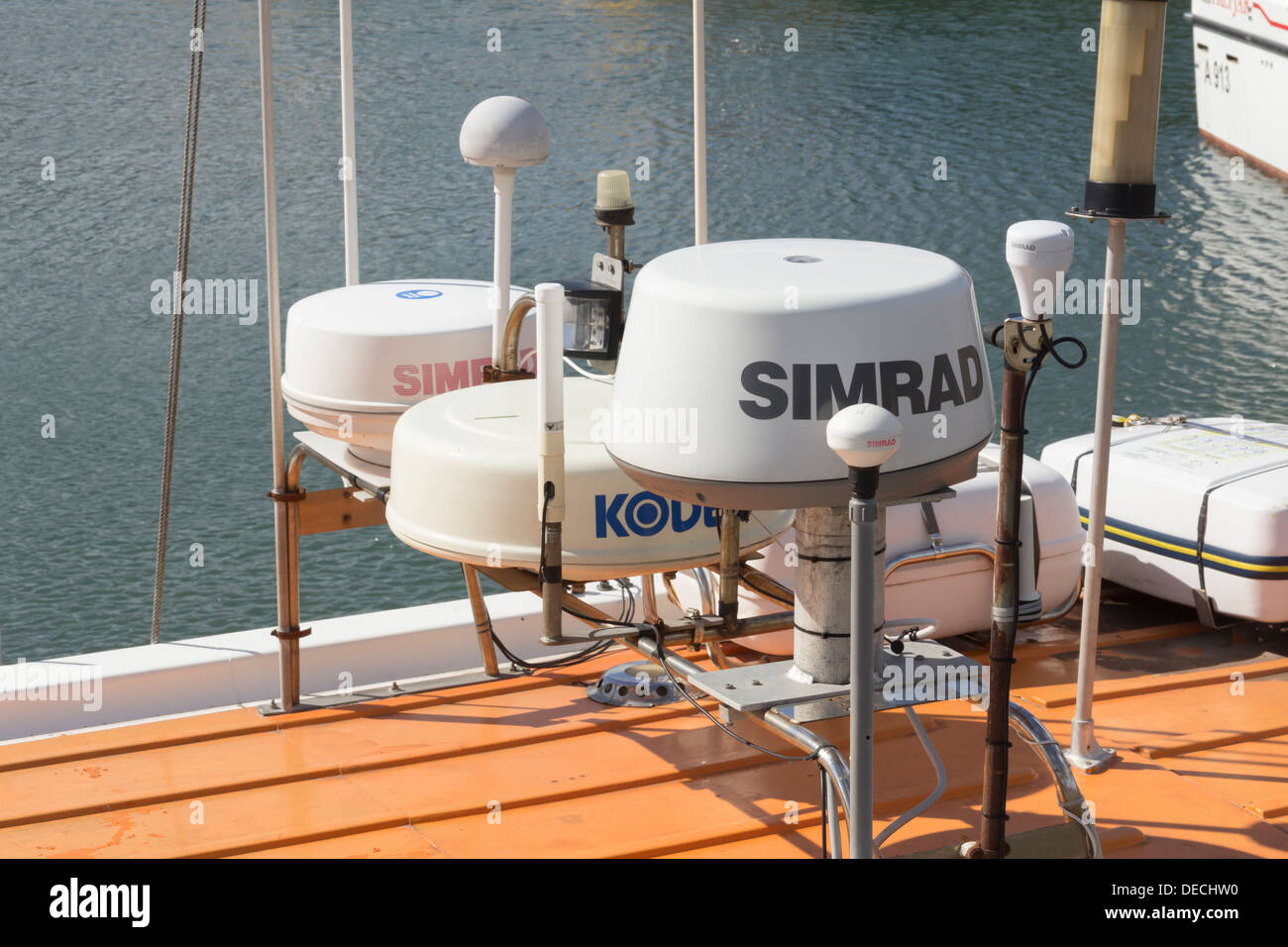 Simrad and Koden radar and marine electronic safety equipment on a boat moored in the harbour at Stonehaven, Scotland. - Stock Image