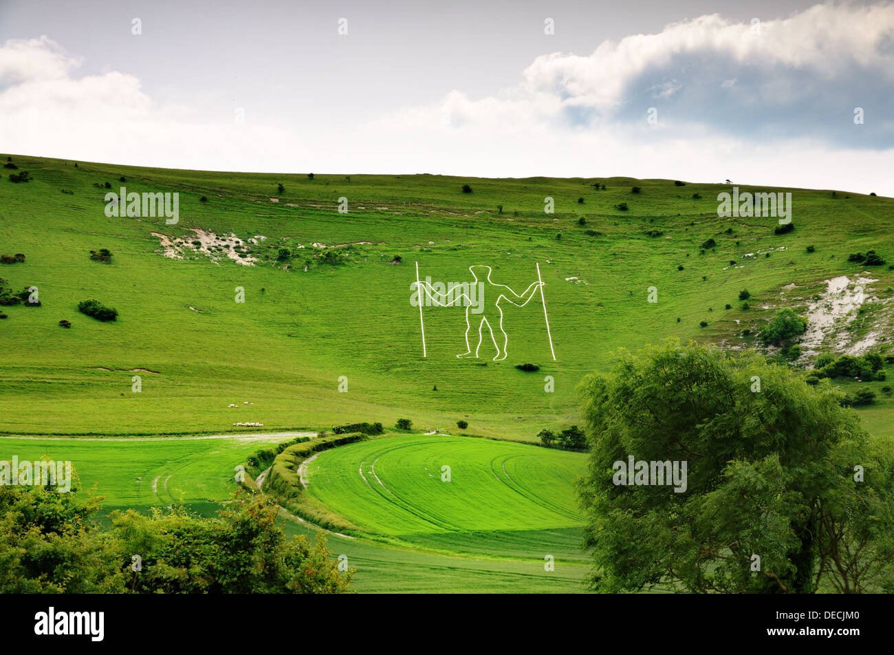 Long Man of Wilmington, a historic chalk cut figure on a hillside in East Sussex, England Stock Photo