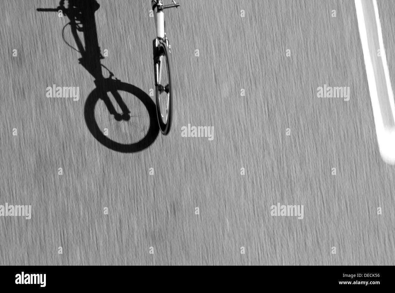 Front wheel motion blur of fast moving speeding racing wheelchair disability bike London marathon 2013 - Stock Image