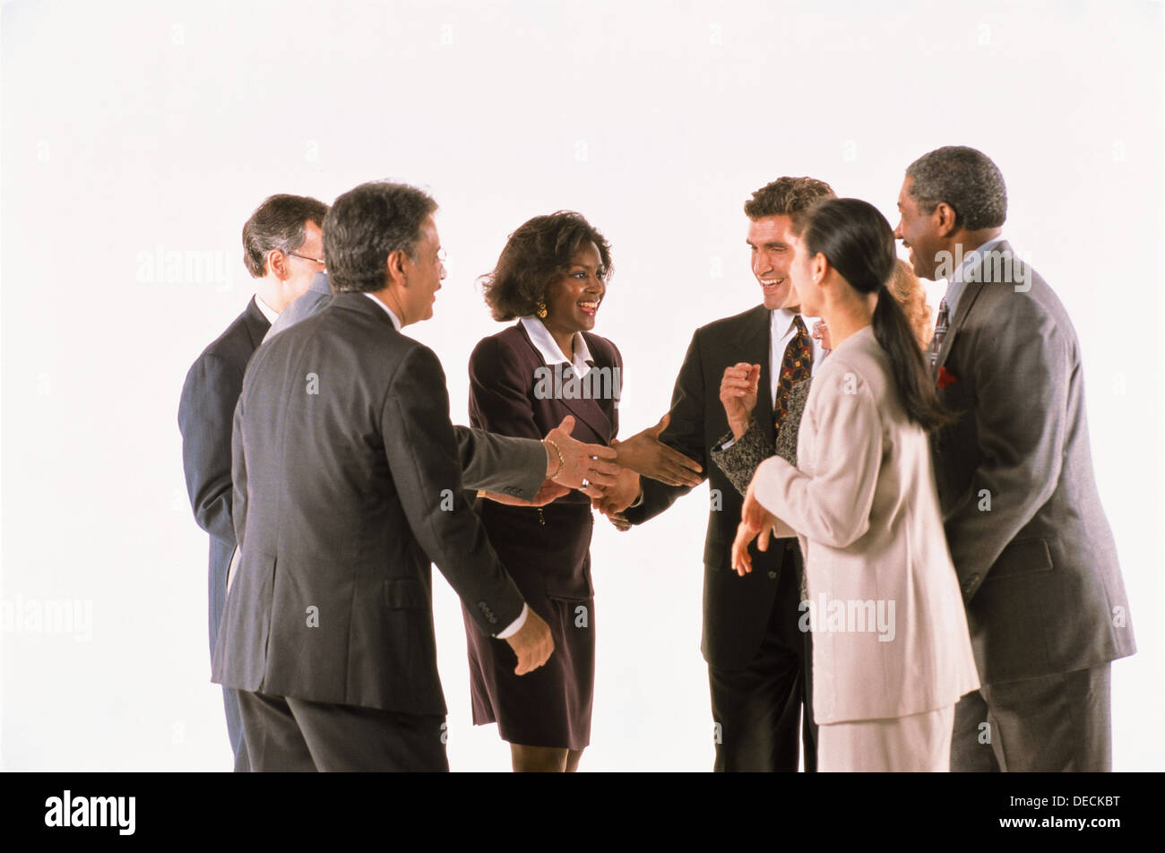 Group of business people greeting each other with a handshake stock group of business people greeting each other with a handshake m4hsunfo