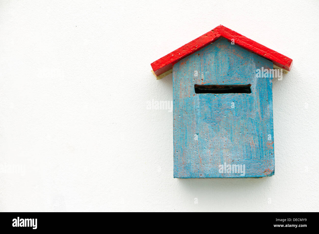 Blue Concrete Mailbox on white wall. - Stock Image