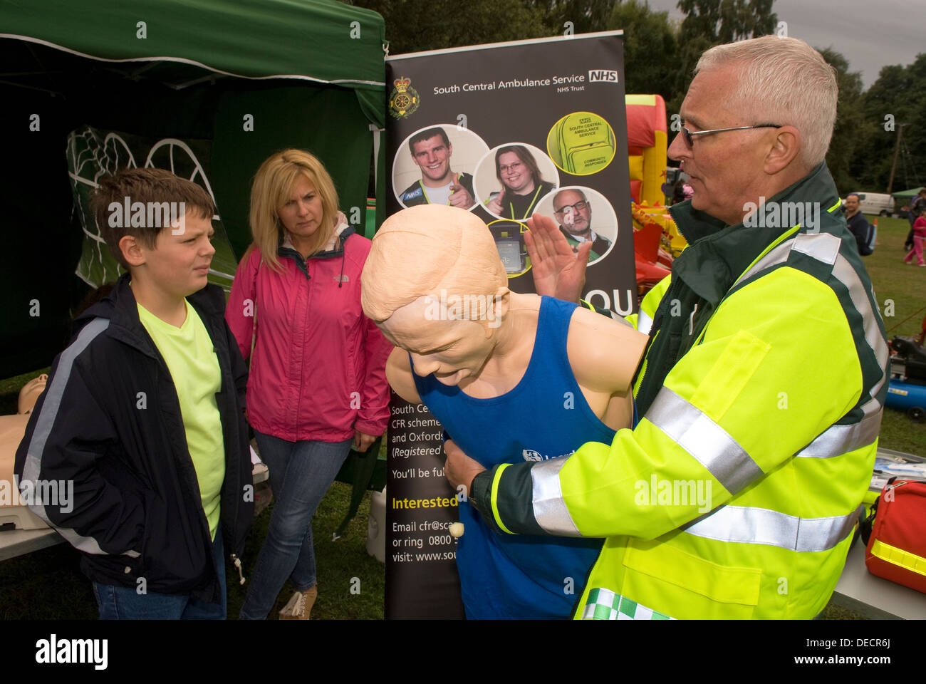 South Central Ambulance personnel giving talk and demo on life saving techniques at an emergency services open day - Stock Image