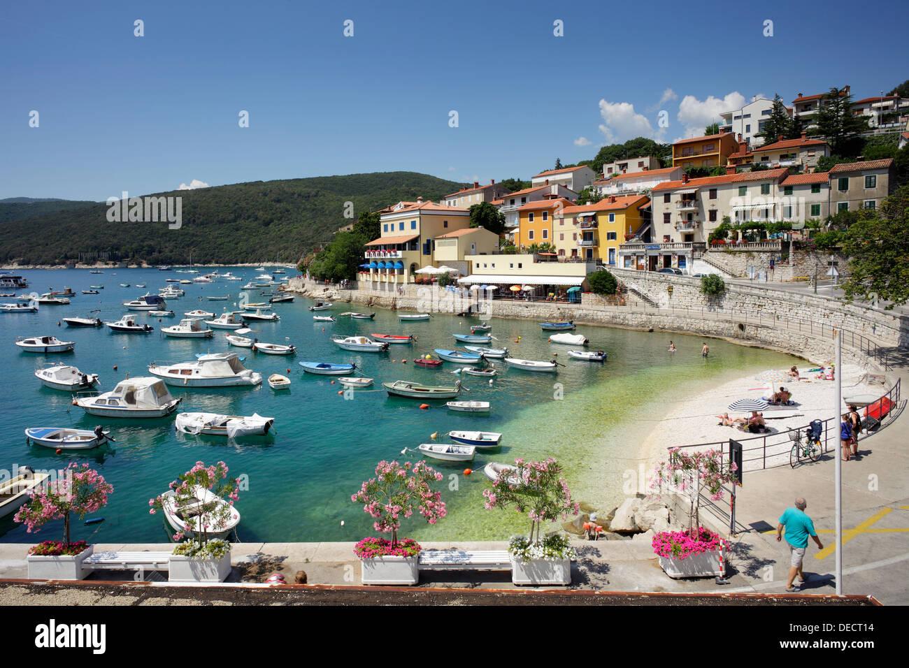 Rabac, Croatia holiday houses on the coast, beach and sport boats at the coast Stock Photo