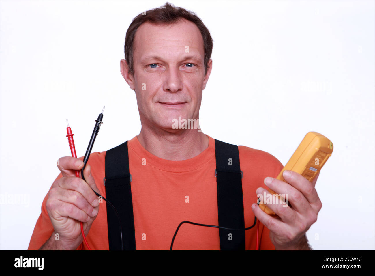 Electrician with a voltmeter - Stock Image