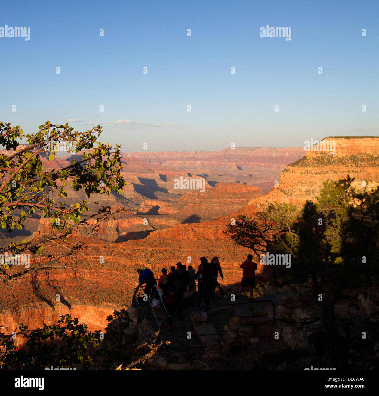 Sightseers (silhouetted) at sunset,Grand Canyon, Arizona - Stock Image