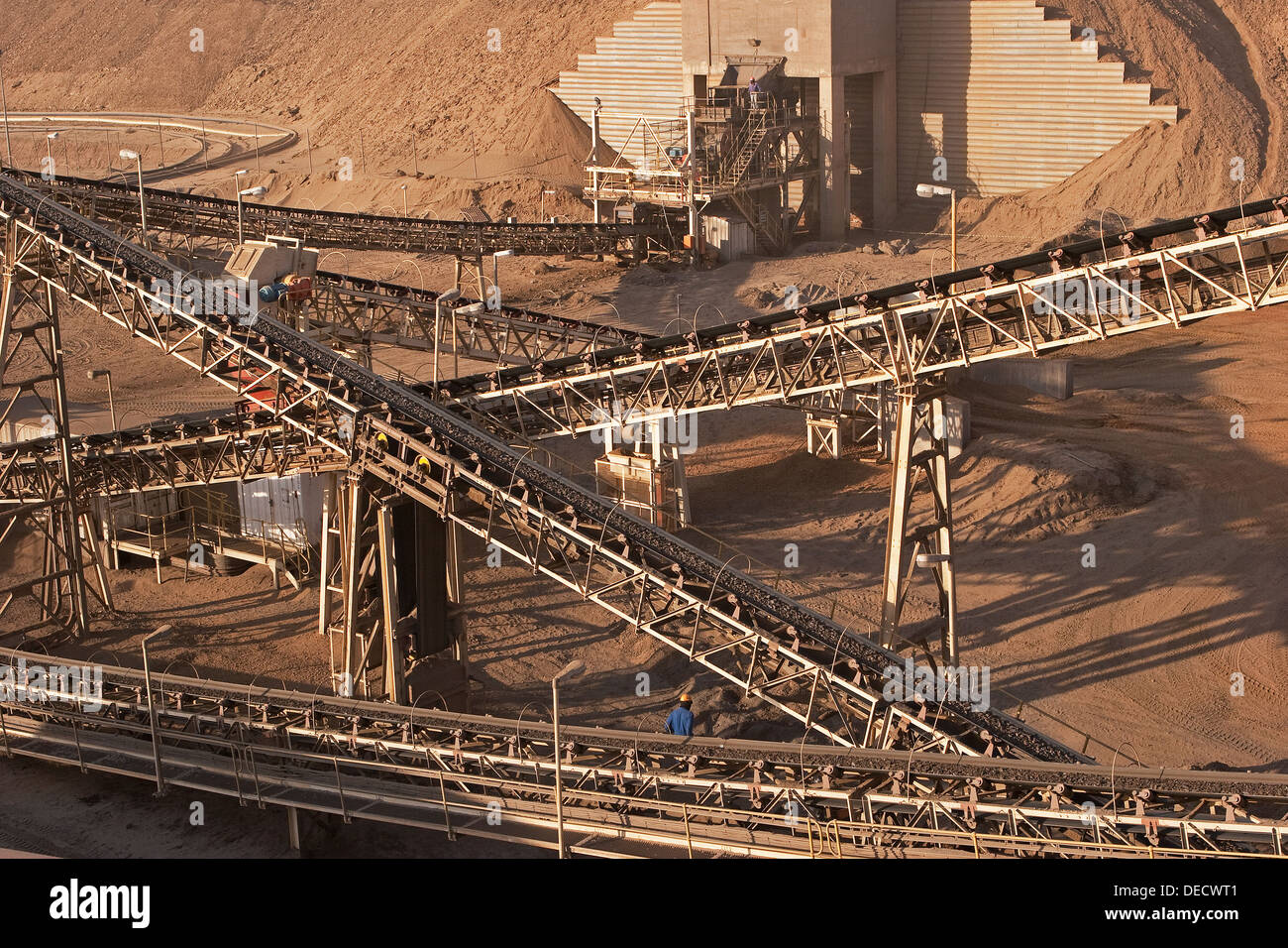 Ore conveyors and crusher on open pit surface gold mine processing plant, Mauritania, NW Africa - Stock Image