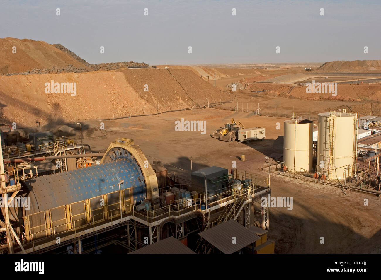 From carbon in leach plant to ball mill and water ponds, on open pit surface gold mine processing plant, Mauritania, NW Africa - Stock Image