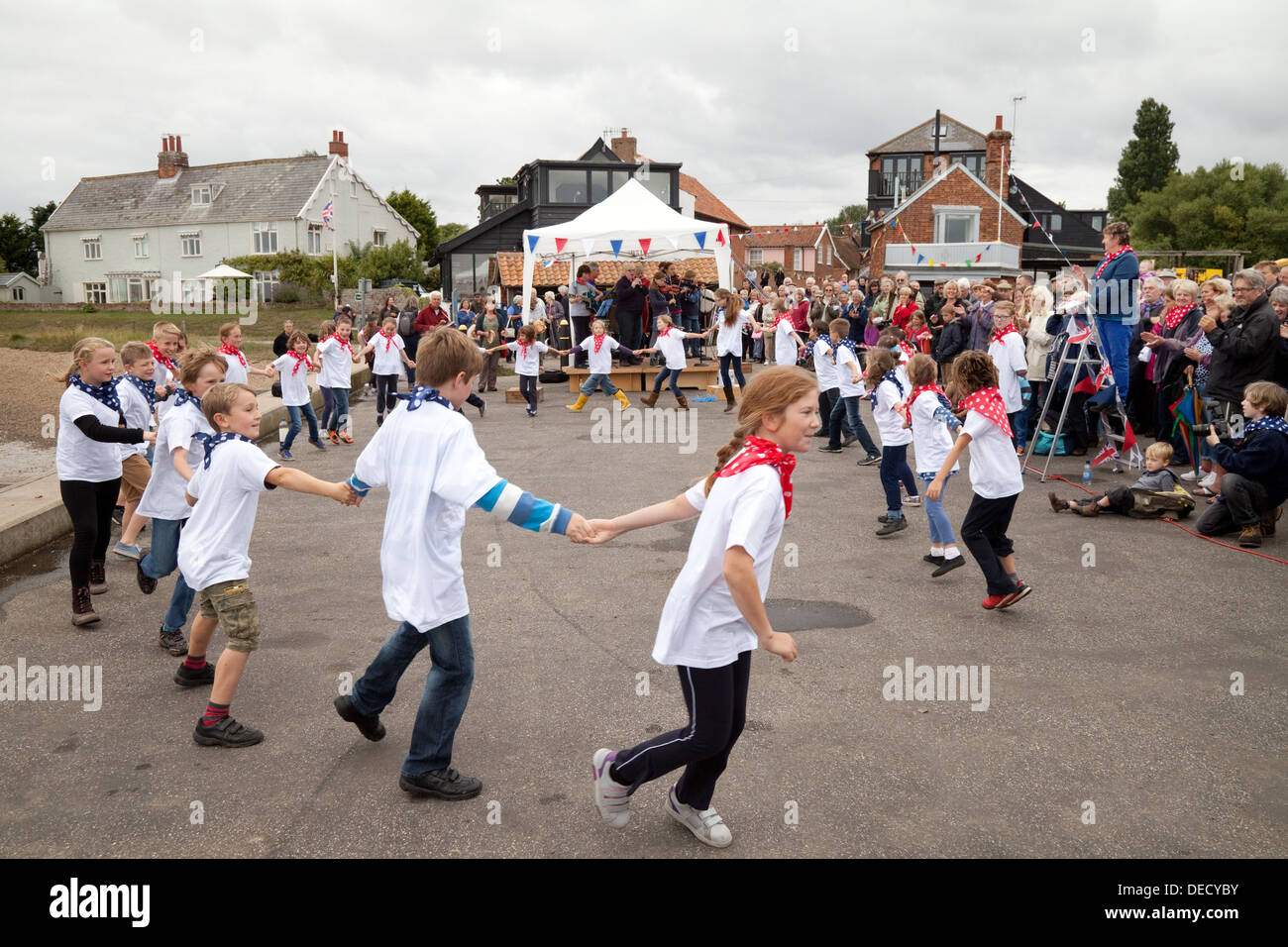Children dancing at a village fair, Orford, village Suffolk England UK - Stock Image
