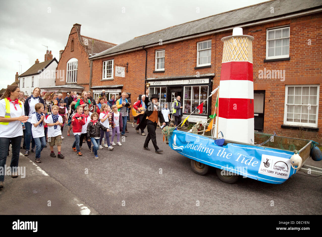 Local village fete and street parade celebrating the lighthouse, Orford, Suffolk UK - Stock Image