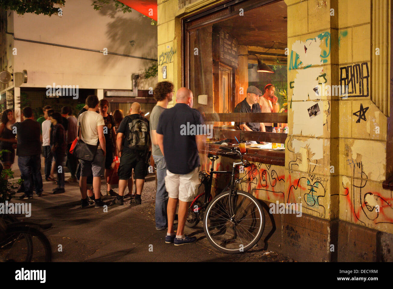 Berlin, Germany, guests of the pub Ae standing on the sidewalk - Stock Image