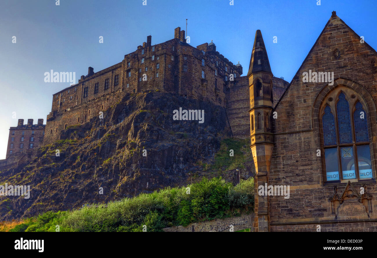 View of Edinburgh castle from low in the Grassmarket, at sunset - Stock Image