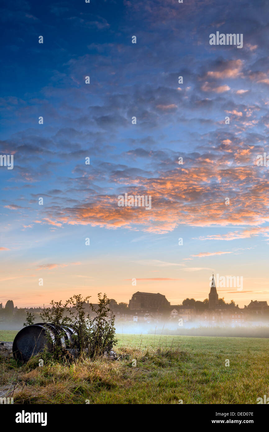 Malmesbury, Wiltshire. Church bells ring across the meadow on a misty September dawn. - Stock Image