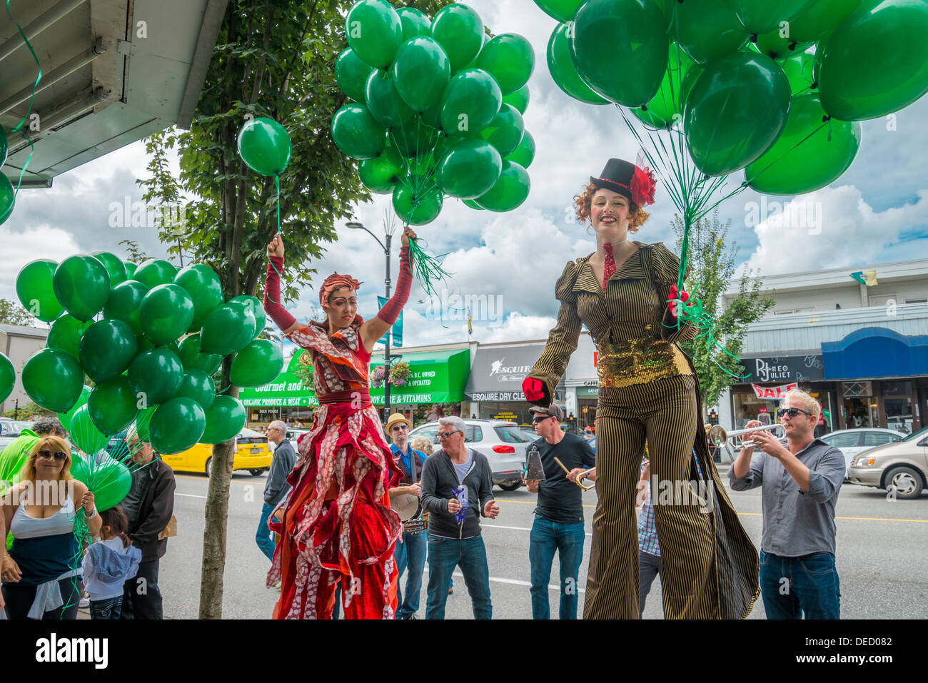 Stilt performers and the Paperboys band at Cambie Village Summer Sizzler event, Vancouver, British Columbia, Canada - Stock Image
