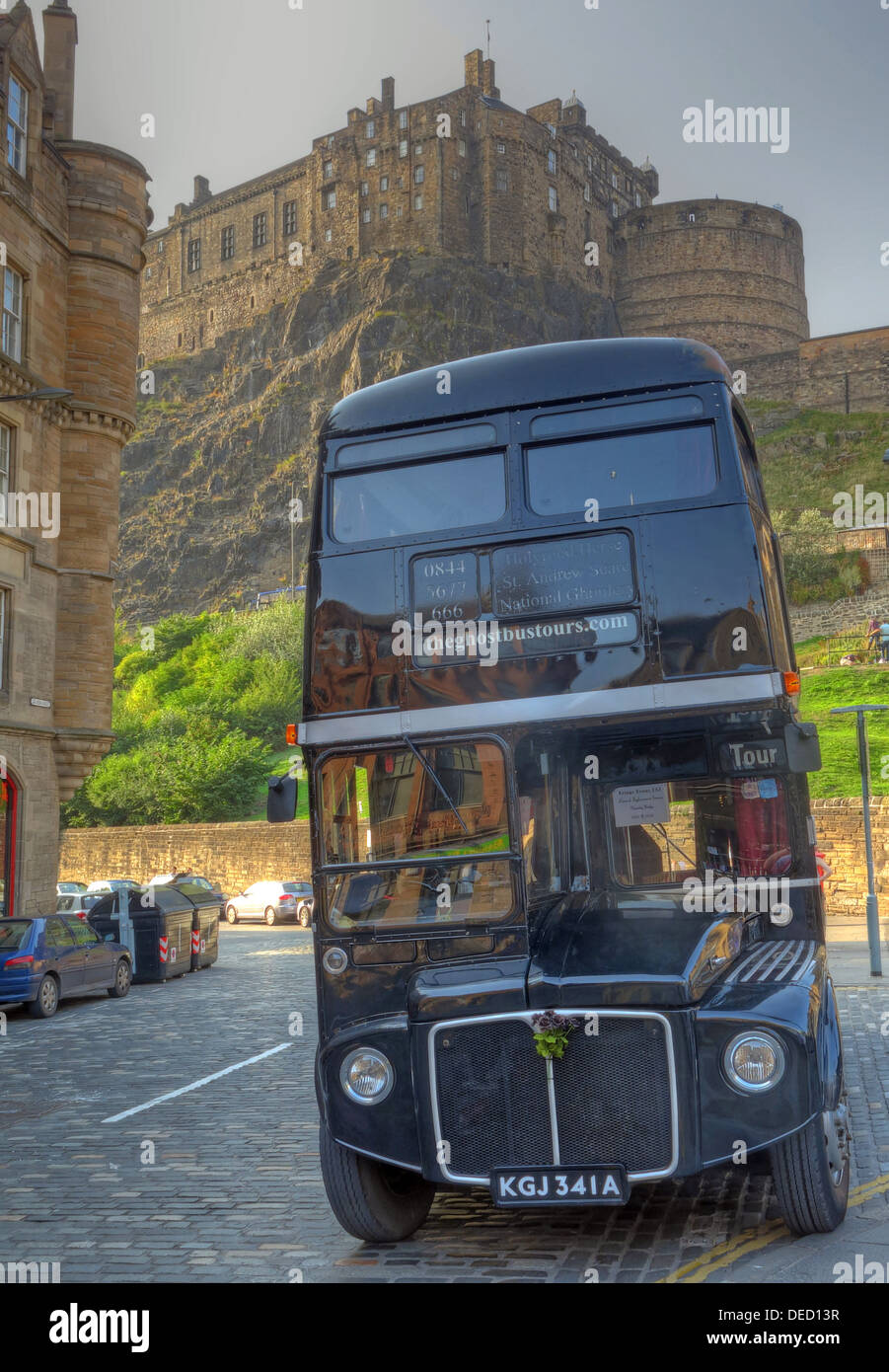 The black London Necrobus, in Edinburgh, Scotland, UK with castle behind. - Stock Image