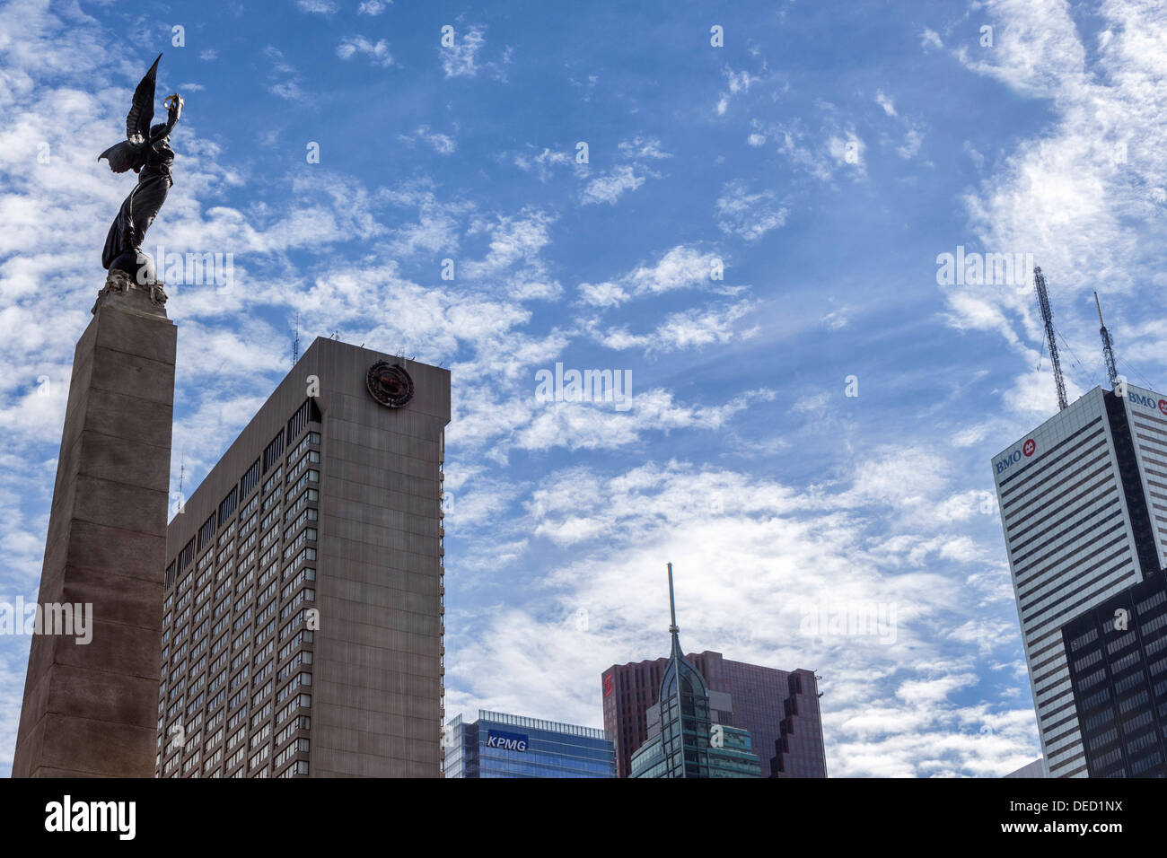 Winged figure on South African war memorial and modern skyscrapers, BMO, Sheraton Hotel, KPMG buildings - Toronto - Stock Image