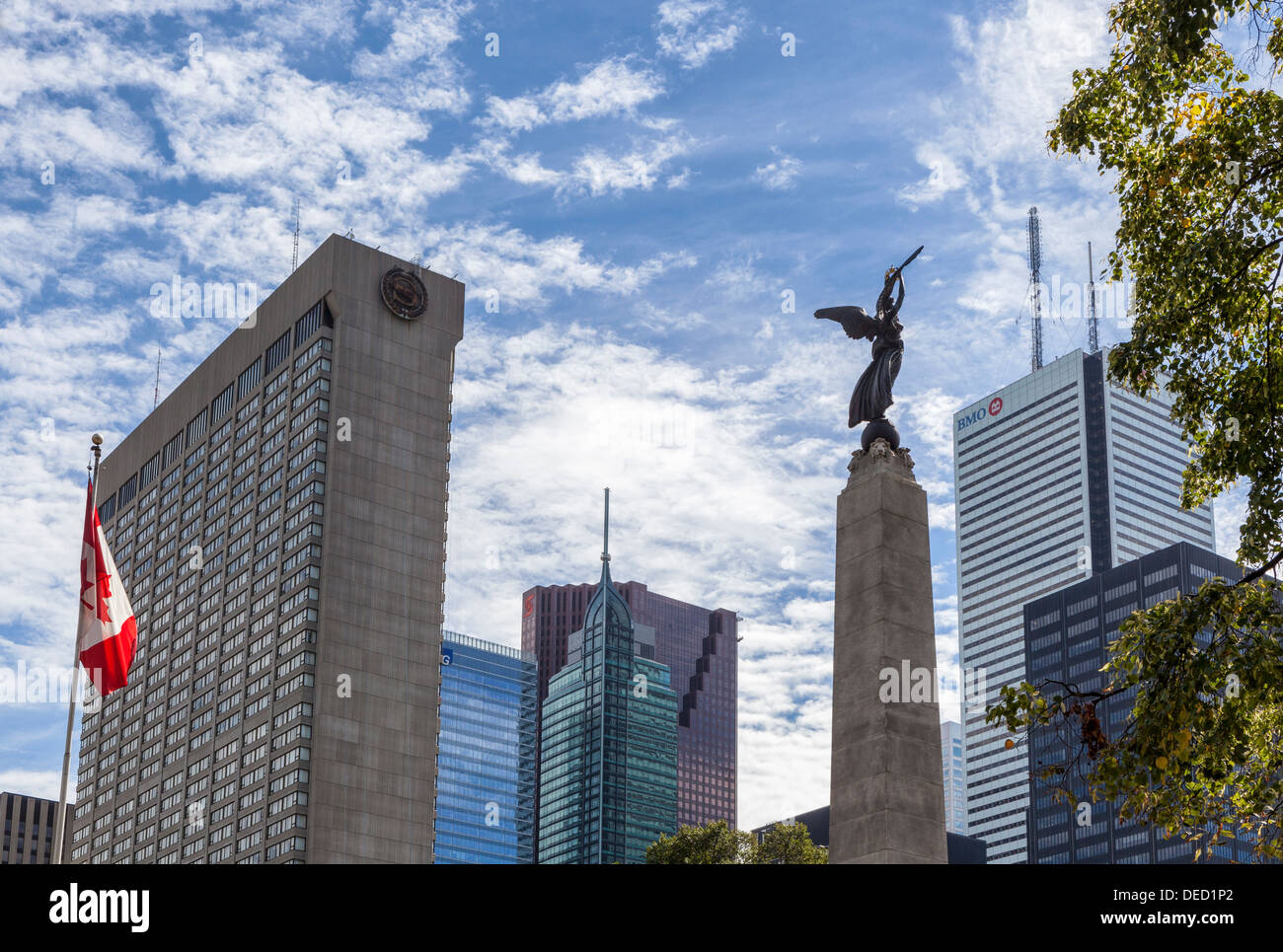 Canadian flag, Winged figure on South African war memorial and modern skyscrapers, BMO, Sheraton Hotel buildings - Toronto - Stock Image