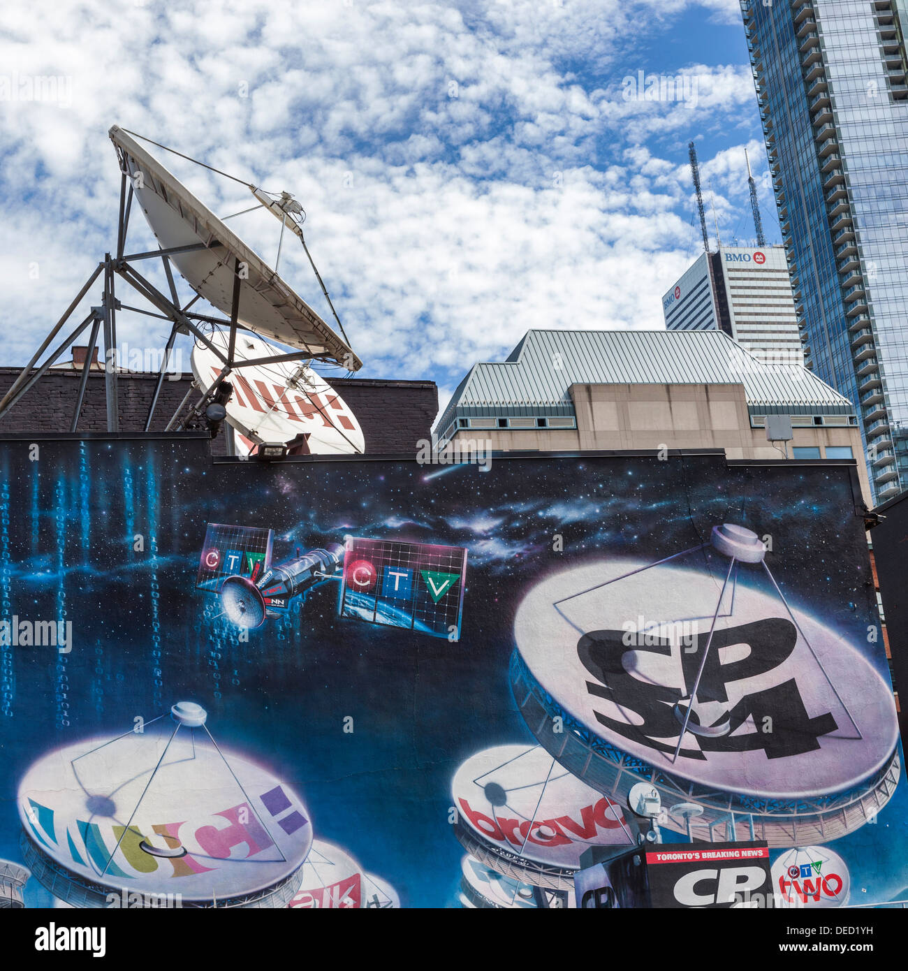 Mural advertisement with satellites and satellite dishes