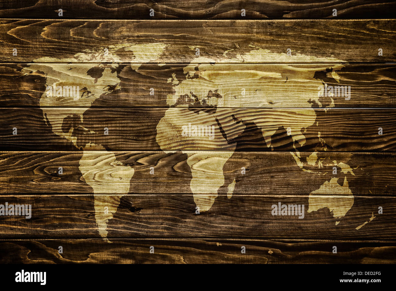 World map on wooden grunge textured background - Stock Image