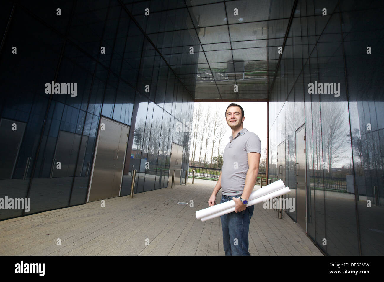 young student architect with drawings - Stock Image
