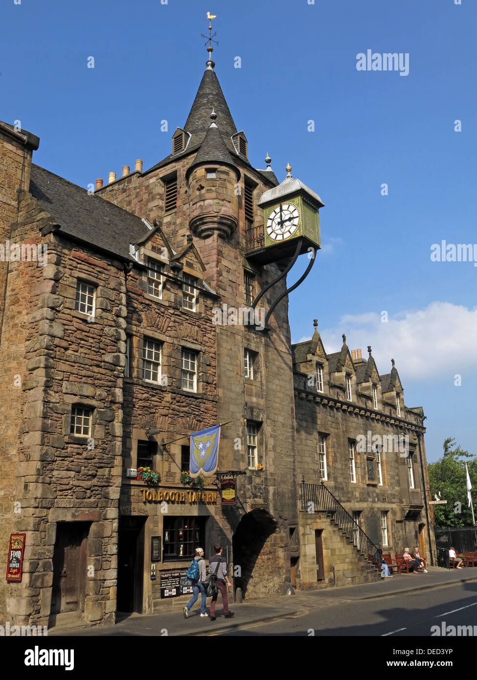 Wide shot Edinburgh Tolbooth Tavern Clock Royal Mile Scotland - Stock Image