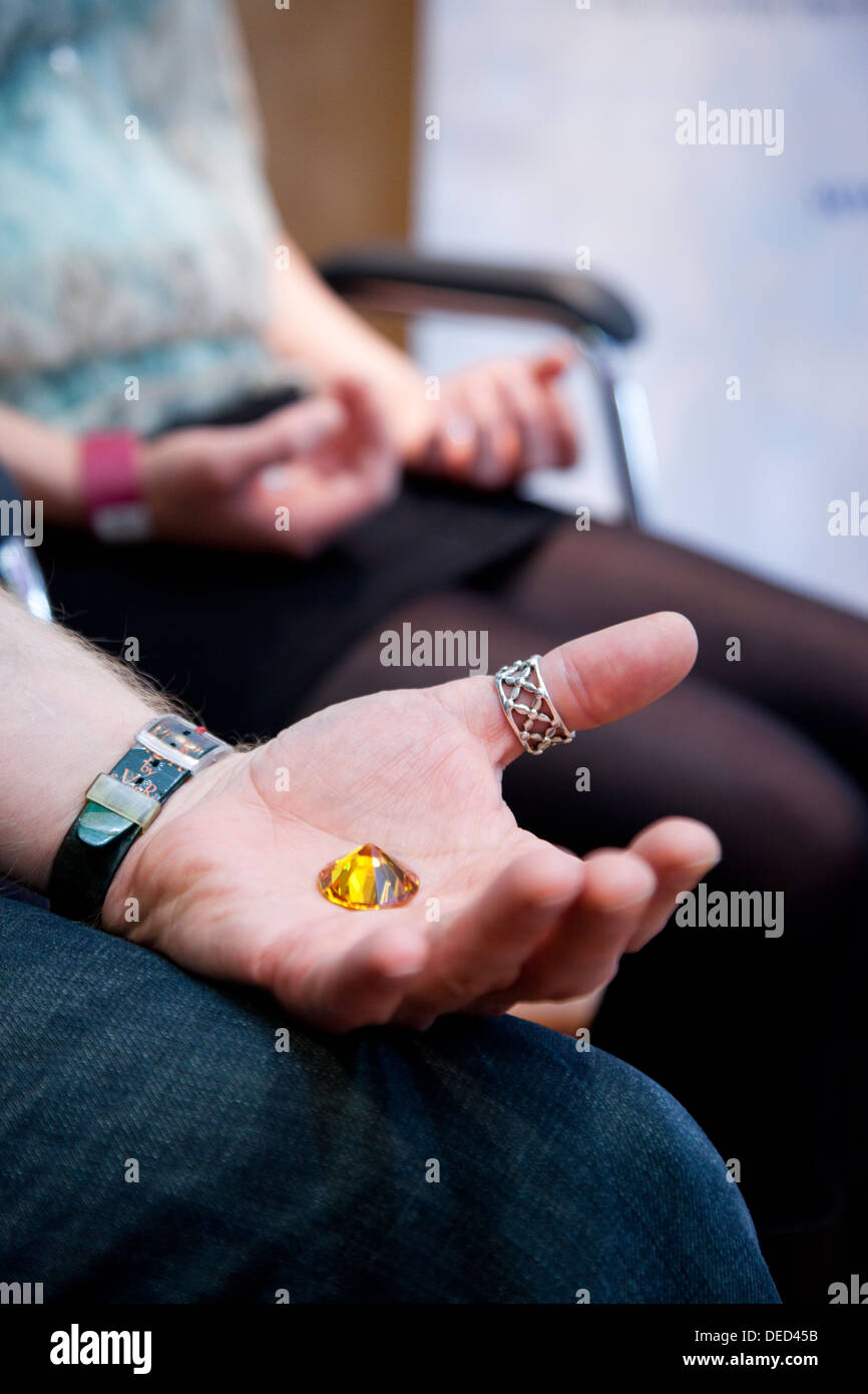 Salzburg, Austria, listeners with a stone in hand on the angel Congress - Stock Image