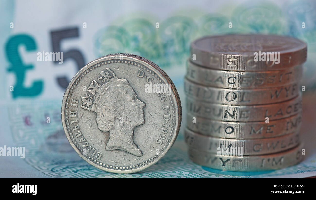 British Sterling Pound coins stacked spelling economy - Stock Image
