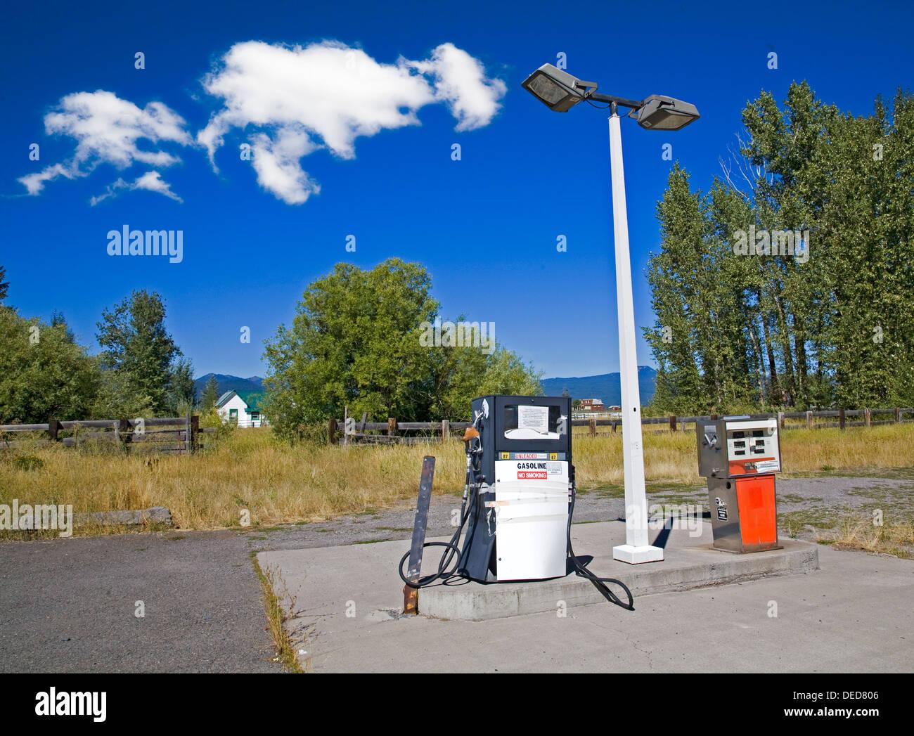 Battered gas pumps at an abandoned service station in Fort Klamath, Oregon - Stock Image