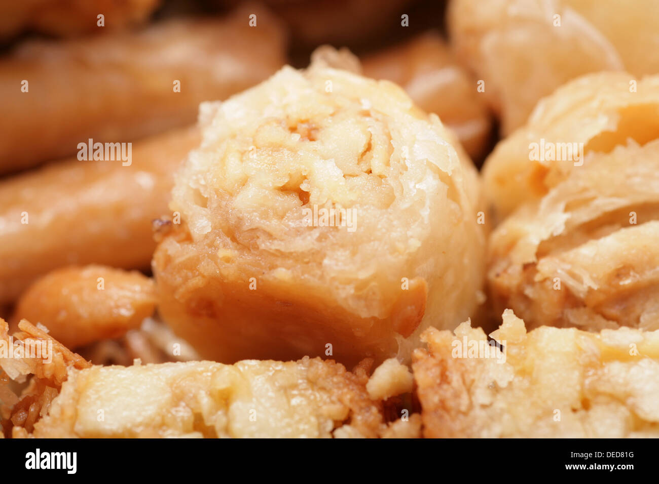 Macro shot of a tasty arabian desert Baklava. Is a rich, sweet pastry made of layers of phyllo pastry filled with Stock Photo