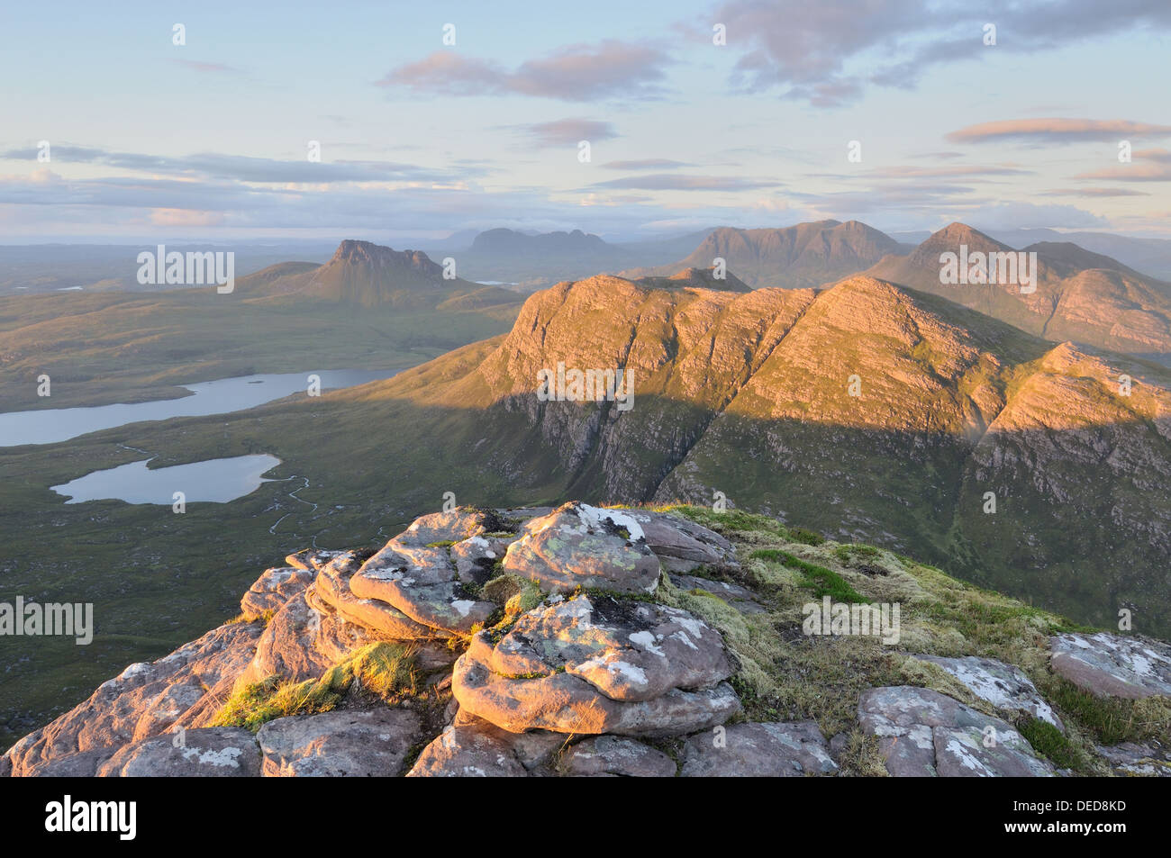 Late evening sunlight on Stac Pollaidh, Beinn an Eoin, Cul Mor, Cul Beag, Suilven and the mountains of Inverpolly, Assynt - Stock Image