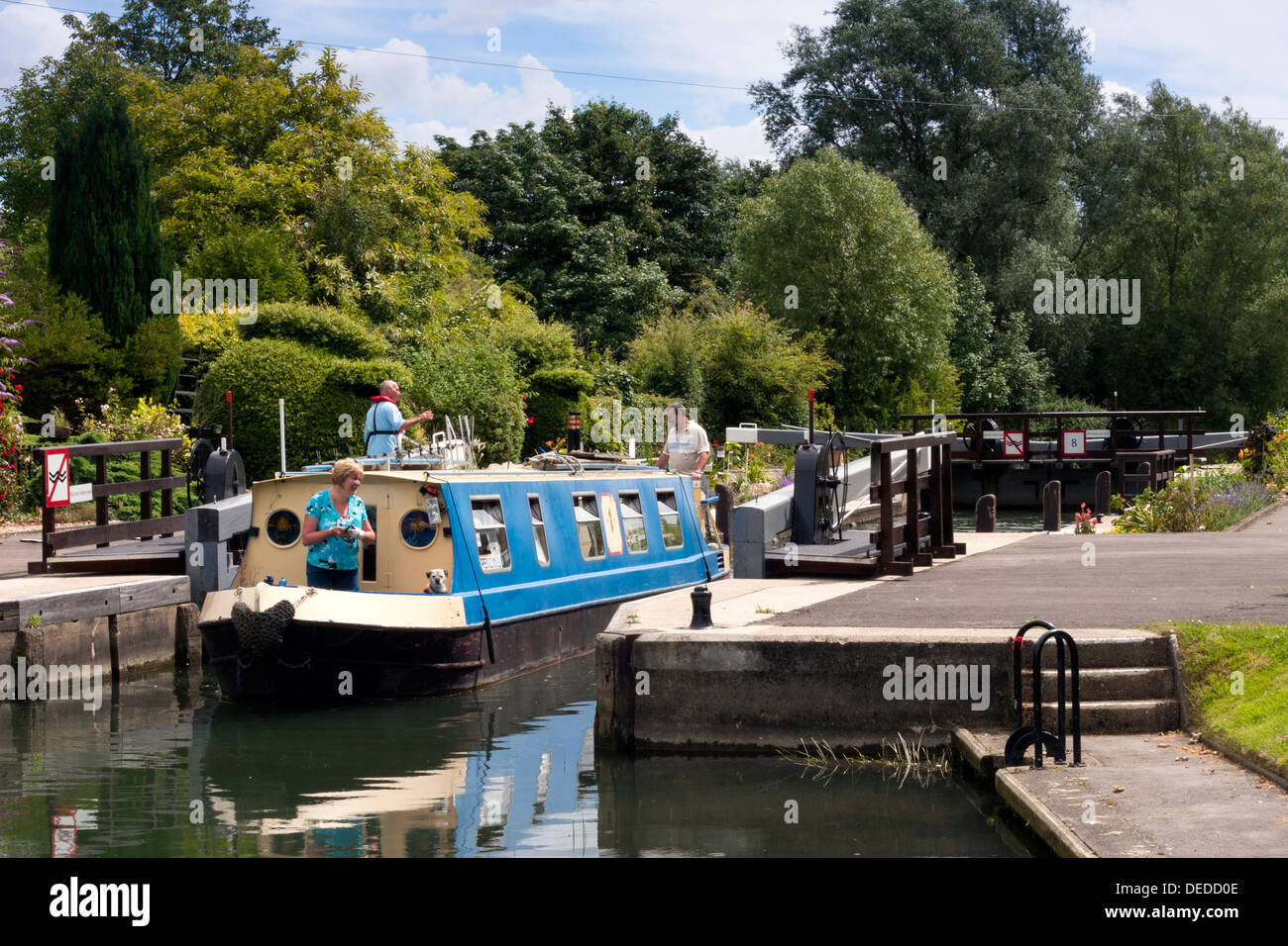 Narrowboat using the lock at Radcot on the River Thames in Oxfordshire - Stock Image