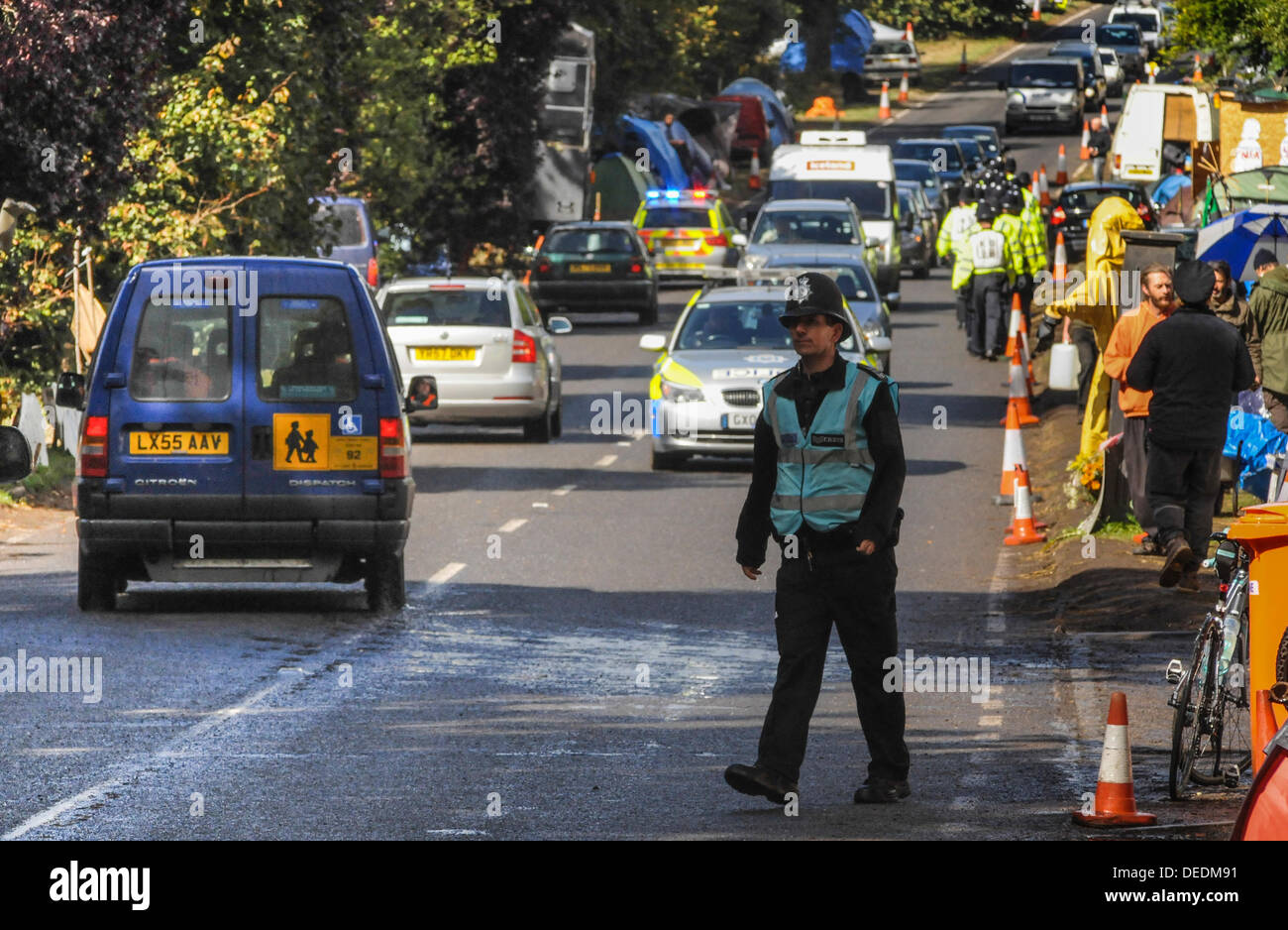 Balcombe,West Sussex, UK. 16th Sept, 2013. Traffic is soon flowing again on the road to Cuadrilla after Police escort another lorry unhindered by protesters. Peaceful atmosphere prevails as protesters chat with Police Officers.   Environmentalist rejoiced after todays failed attempt by West Sussex County  in the high court, due flawed case, to evict them from the road side camp. © David Burr/Alamy Live News - Stock Image