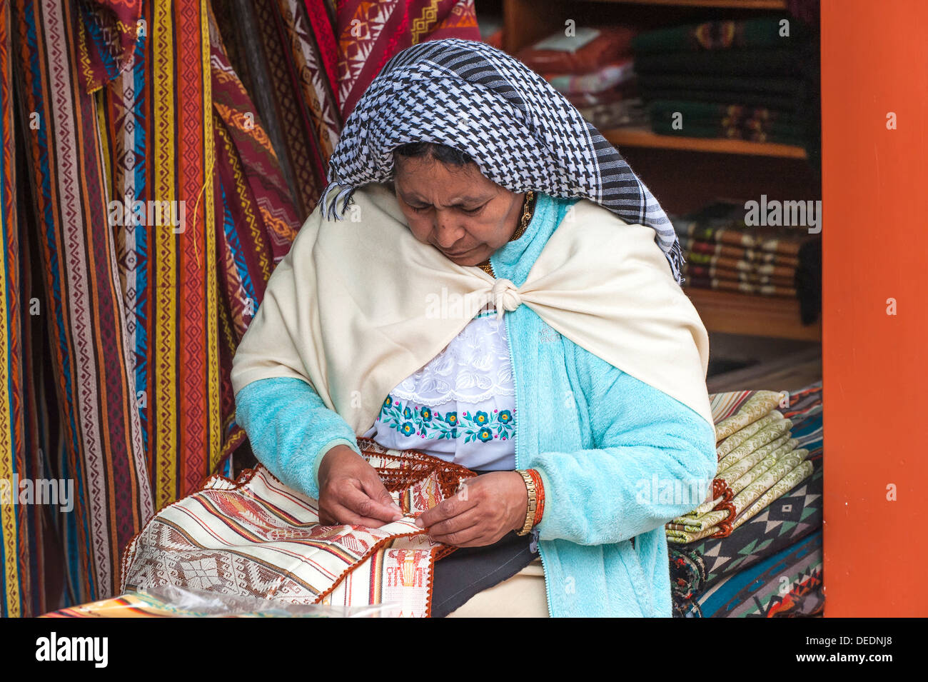 Woman embroidering, Otavalo market, Imbabura Province, Ecuador, South America - Stock Image